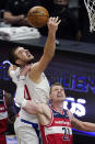 Los Angeles Clippers center Ivica Zubac, left, and Washington Wizards center Moritz Wagner go after a rebound during the second half of an NBA basketball game Tuesday, Feb. 23, 2021, in Los Angeles. The Clippers won 135-116. (AP Photo/Mark J. Terrill)