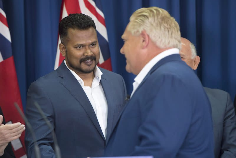 "<p>This week, Toronto police confirmed Nallaratnam, left, was under investigation for allegedly sending a threatening email during the election campaign, multiple news outlets reported. <a rel=""nofollow"" href=""https://www.theglobeandmail.com/canada/article-toronto-police-investigating-conduct-of-officer-running-for-pcs-in/"">According to <em>The Globe and Mail</em></a>, the email contains explicit language and says: ""… don't do nasty campaign against me. I will teach the lesson after election."" Nallaratnam said the email, which was reportedly sent to nearly 100 people, is a fake and was not written by him. ""I did not send the e-mail in question. The e-mail is a fabrication from an account that does not belong to me,"" Nallaratnam said in a statement. Ford revealed he spoke to the candidate and takes him at his word, which is why the PCs have decided to stick with him, <a rel=""nofollow"" href=""https://www.thestar.com/news/queenspark/2018/06/04/police-investigating-pc-candidate-over-threat-allegation.html"">the <em>Toronto Star</em> reported</a>. Photo from The Canadian Press. </p>"