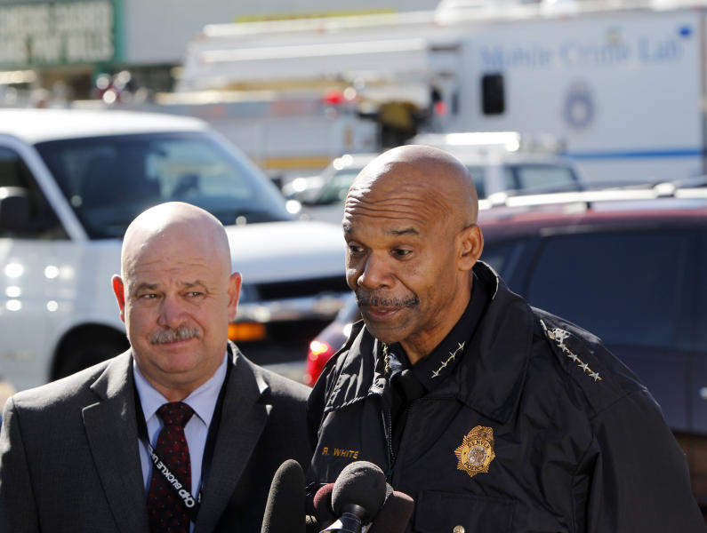 Denver Police Chief Robert White speaks at a news conference across the street from Fero's Bar and Grill in Denver on Wednesday, Oct. 17, 2012, where the bodies of a man and four woman were discovered after firefighters extinguished a fire at the bar early Wednesday morning. Police think the blaze was set to cover up their slayings. Commander Ronald Saunier listens at left. (AP Photo/Ed Andrieski)