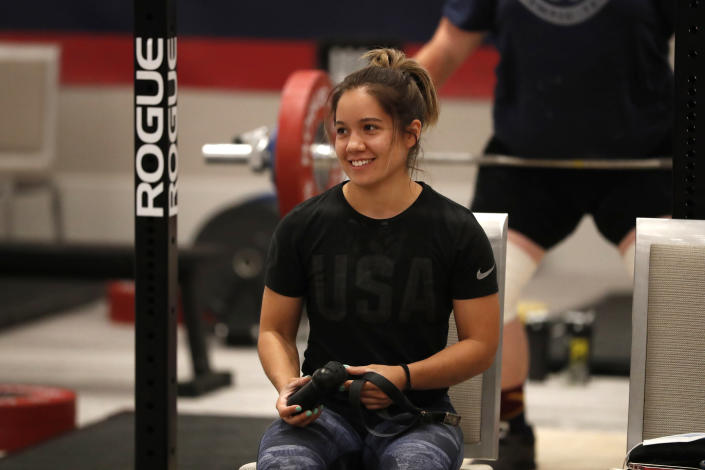 """Olympic weightlifter Jourdan Delacruz trains inside a Waikiki hotel Tuesday, July 13, 2021, in Honolulu. The playbook for athletes provides a guide to a """"safe and successful Games"""" for the Tokyo Olympics. It's filled with """"cannots"""" and """"do nots,"""" meaning a once-in-a-liftetime opportunity will be a whole lot less fun. (AP Photo/Marco Garcia)"""
