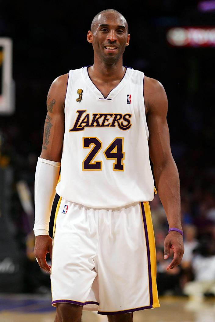 Kobe Bryant smiles in the final seconds against the Boston Celtics in Game Five of the 2008 NBA Finals on June 15, 2008, at the Staples Center. / Credit: Lisa Blumenfeld / Getty