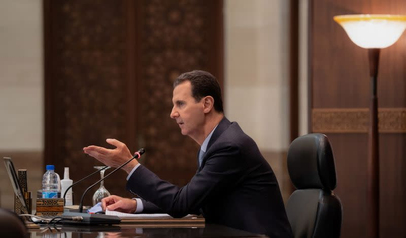 Syria's President Bashar al-Assad meets with the Syrian cabinet in Damascus