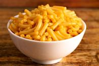 """<p>Boxed macaroni and cheese is easy and delicious, but it doesn't make a great meal on a regular basis. It's full of highly processed ingredients, sodium, and preservatives. There's a long list of non-food ingredients and virtually no nutrients. In 2017, the <em><a href=""""https://www.nytimes.com/2017/07/12/well/eat/the-chemicals-in-your-mac-and-cheese.html"""" rel=""""nofollow noopener"""" target=""""_blank"""" data-ylk=""""slk:New York Times"""" class=""""link rapid-noclick-resp"""">New York Times</a></em> reported that phthalates, potentially harmful chemicals that were banned from children's teething rings and toys a decade ago, may still be present in boxed mac and cheese.<br></p><p>Instead of the boxed stuff, make your own mac and cheese at home with real ingredients. </p>"""