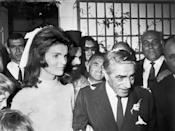 <p>The former First Lady marries her second husband, Aristotle Onassis, on his private island Skorpios, located off the coast of Greece. Jackie wore a knee-length ivory lace dress designed by Valentino and a white ribbon in her hair.<br></p>