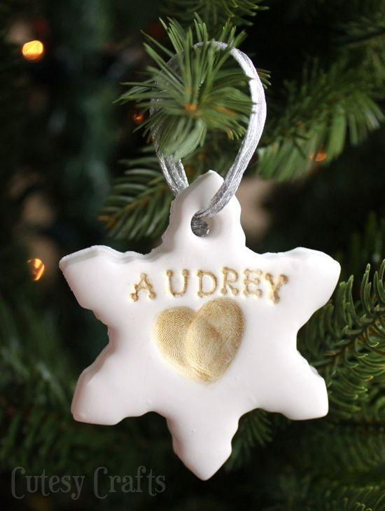 "<p>Roll out clay and cut with holiday cookie cutters of your choosing. (Don't forget to cut out a hole for hanging using a straw.) Let kids press two overlapping prints from an index finger into the center to create the look of a heart.</p><p><em><a href=""https://cutesycrafts.com/2014/12/kids-fingerprint-handmade-christmas-ornaments.html"" rel=""nofollow noopener"" target=""_blank"" data-ylk=""slk:Get the tutorial at Cutesy Crafts»"" class=""link rapid-noclick-resp"">Get the tutorial at Cutesy Crafts»</a></em><br></p>"