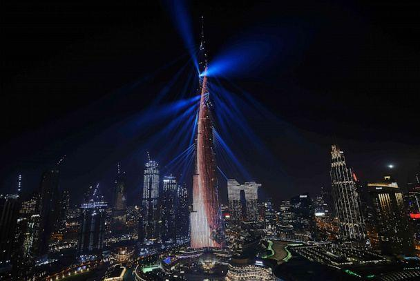 PHOTO: Dubai's Burj Khalifa is lit up in the shape of a space rocket on Feb. 9, 2021, as the UAE's Al-Amal probe successfully entered Mars' orbit, making history as the Arab world's first interplanetary mission. (Giuseppe Cacace/AFP via Getty Images)