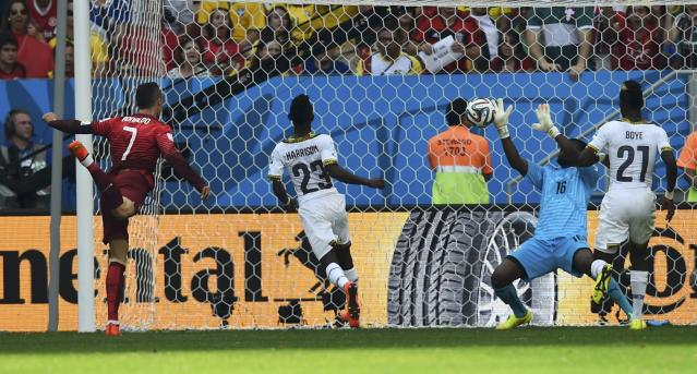 Ghana's goalkeeper Fatau Dauda (2nd R) stops a shot by Portugal's Cristiano Ronaldo (L) during their 2014 World Cup Group G soccer match at the Brasilia national stadium in Brasilia June 26, 2014. REUTERS/Dylan Martinez (BRAZIL - Tags: SOCCER SPORT WORLD CUP)