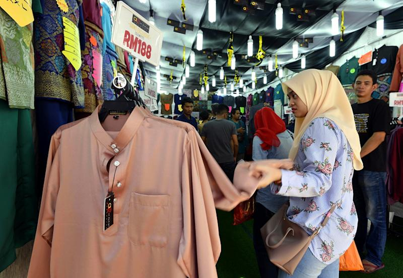 A woman shops for Raya at Jalan Masjid India, Kuala Lumpur June 2, 2018. — Picture by Ham Abu Bakar