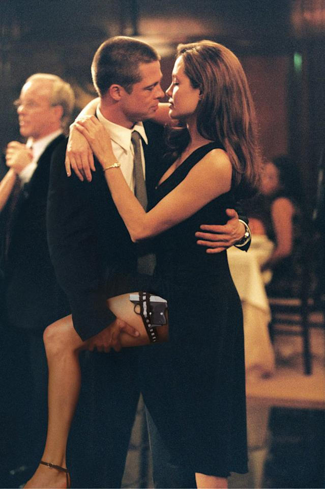 "In 2005's ""Mr. and Mrs. Smith,"" both husband and wife worked as spies. Seriously, though, who cares about the plot?! This flick will forever be known as the one that created Brangelina, since Brad Pitt began filming while married to Jen Aniston, but was taking vacations with co-star Angelina Jolie by the time it hit theaters 17 months later. We really, really wanted to hate them together, but no one could deny the sparks. © 2005 Twentieth Century Fox"