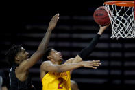Maryland guard Aaron Wiggins (2) goes up for a shot against Michigan State forward Aaron Henry during the second half of an NCAA college basketball game, Sunday, Feb. 28, 2021, in College Park, Md. Maryland won 73-55. (AP Photo/Julio Cortez)