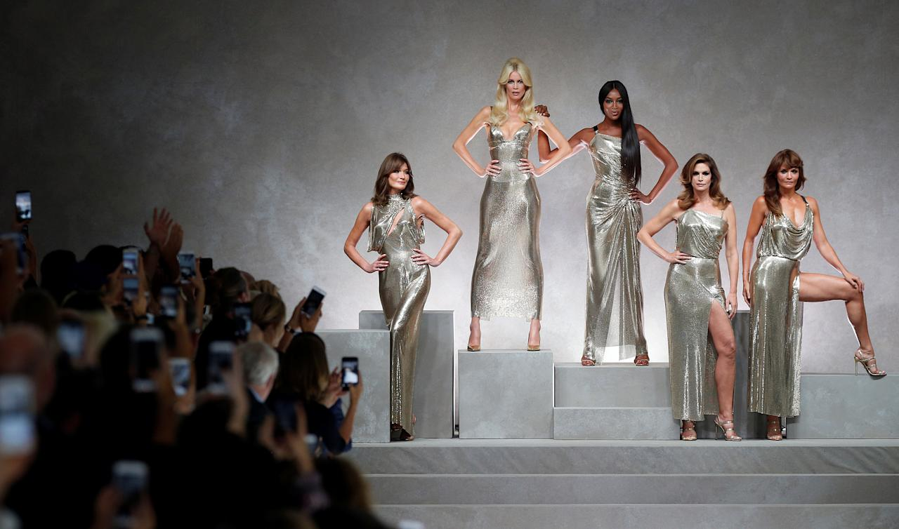 Former top models Carla Bruni (L), Claudia Schiffer, Naomi Campbell, Cindy Crawford and Helena Christensen display iconic  creations of late Italian designer Gianni Versace's during the Versace Spring/Summer 2018 show at the Milan Fashion Week in Milan, Italy, September 22, 2017. REUTERS/Stefano Rellandini     TPX IMAGES OF THE DAY