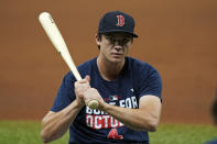 Boston Red Sox first baseman Bobby Dalbec holds a bat during the baseball team's practice Wednesday, Oct. 6, 2021, in St. Petersburg, Fla., for an AL Division Series matchup against the Tampa Bay Rays that starts Thursday. (AP Photo/Chris O'Meara)