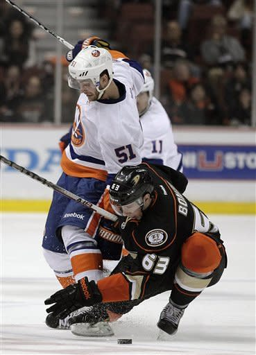 New York Islanders center Frans Nielsen, top, and Anaheim Ducks center Nick Bonino fight for a puck during the first period of an NHL hockey game in Anaheim, Calif., Friday, Jan. 6, 2012. (AP Photo/Jae C. Hong)