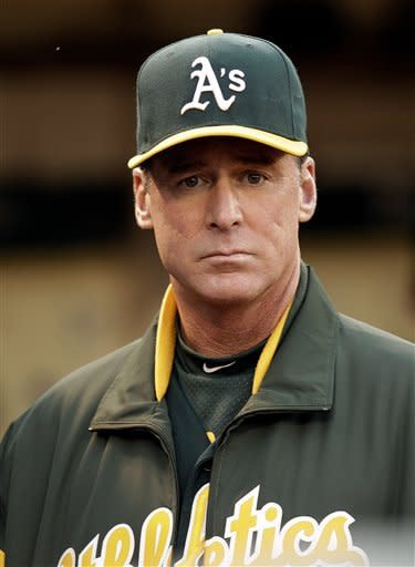 Oakland Athletics manager Bob Melvin waits for the baseball game to begin against the Boston Red Sox Friday, Aug. 31, 2012, in Oakland, Calif. (AP Photo/Ben Margot)