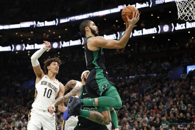 Boston Celtics' Jayson Tatum goes to the basket past New Orleans Pelicans' Jaxson Hayes during the first quarter of an NBA basketball game Saturday, Jan. 11, 2020, in Boston. (AP Photo/Winslow Townson)