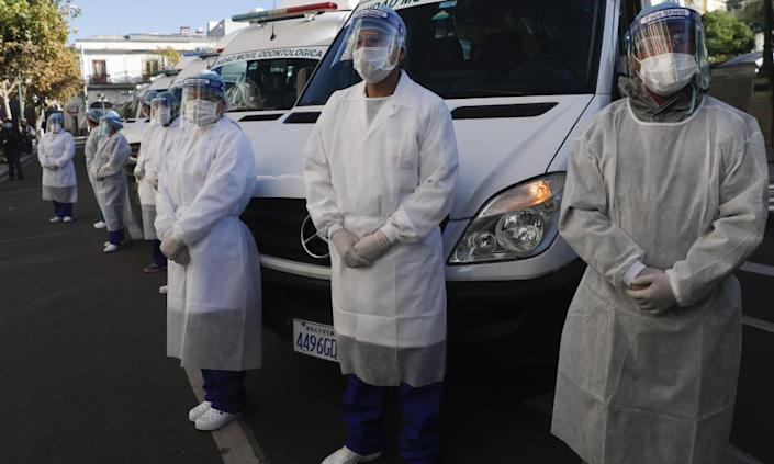 "<span class=""element-image__caption"">Healthcare workers stand dressed in full protection gear during an inspection in La Paz, Bolivia, on 28 May before departing to the Amazonian region of Beni in a caravan of medical teams to help in the fight against the new coronavirus pandemic.</span> <span class=""element-image__credit"">Photograph: Juan Karita/AP</span>"