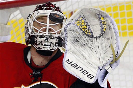 Calgary Flames goalie Miikka Kiprusoff, from Finland, makes a save against the San Jose Sharks during the second period of an NHL hockey game in Calgary, Alberta, Wednesday, March 6, 2013. (AP Photo/The Canadian Press, Jeff McIntosh)
