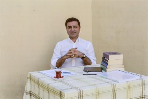 A handout photo provided by the pro-Kurdish Peoples's Democratic Party (HDP) shows former party leader Selahattin Demirtas in prison from where he is campaigning for president in the June elections