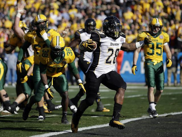 Towson running back Terrance West (28) steps into the end zone for a touchdown against North Dakota State in the first half of the FCS championship NCAA college football game, Saturday, Jan. 4, 2014, in Frisco, Texas. (AP Photo/Tony Gutierrez)