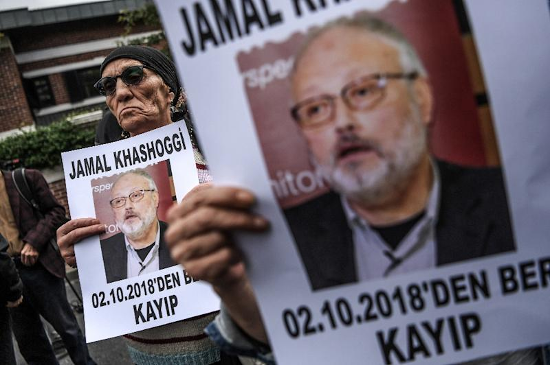"A file photo taken on October 9, 2018 shows protesters holding portraits of missing Riyadh critic Jamal Khashoggi with the caption: ""Jamal Khashoggi is missing since October 2"" during a demonstration in front of the Saudi Arabian consulate (AFP Photo/OZAN KOSE)"