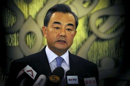 Chinese Foreign Minister Wang Yi speaks during a news conference after meeting with Singaporean officials in Singapore
