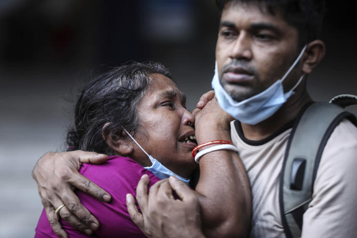 A Bangladeshi woman mourns the death of her husband who died of COVID-19 at a hospital in Dhaka, Bangladesh, Friday, May 7, 2021. India's surge in coronavirus cases is having a dangerous effect on neighboring Bangladesh. Health experts warn of imminent vaccine shortages just as the country should be stepping up its vaccination drive, and as more contagious virus variants are beginning to be detected. (AP Photo/Mahmud Hossain Opu)