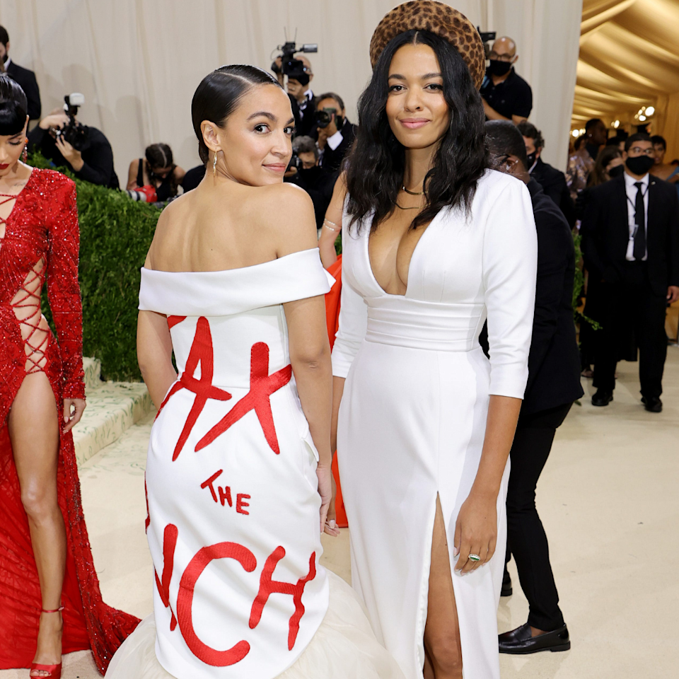 Rep. Alexandria Ocasio-Cortez (D-N.Y.), at left standing next to Aurora James, attends The 2021 Met Gala Celebrating In America: A Lexicon Of Fashion at Metropolitan Museum of Art on Monday, September 13, 2021 in New York City.