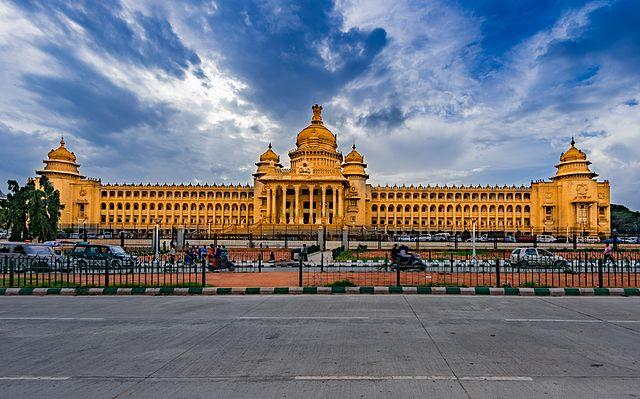 <p>India's Silicon Valley has been ranked as the city with the most conducive environment for trade and digitalisation, as per a survey on business confidence by the Economist Intelligence Unit. A JLL ranking of the world's most dynamic cities has also ranked Bengaluru number 1, with the city constantly adapting and leveraging technology and innovation to come on top.<br /><br />While the city is home to the nation's largest IT companies, with Infosys, Wipro, Mphasis and Mindtree all headquartered there, it has also been the breeding ground for a number of startups including Flipkart, Ola, InMobi, Quikr and Mu Sigma. The city also has some of the largest technology parks in India – Electronic City with around 200 IT and ITES companies, Bagmane Tech Park, International Tech Park (ITPL) and Embassy Golf Links. It is also home to leading educational institutions such as the prestigious Indian Institute of Management Bangalore (IIM-B), National Institute of Design, National Law School of India and National Institute of Fashion Technology. A cosmopolitan culture also adds on to the ease of doing business in the city. The Bengaluru real estate market has also been relatively stable in the city.<br />Where the city lags behind is in traffic management, with the city unable to keep up to the exploding road transport situation which has made commuting on the city's roads a nightmare. However, the Bengaluru metro, the second largest metro system in India after New Delhi, has made commuting relatively easier.<br /><br />By Bikashrd – Own work, CC BY-SA 4.0, https://commons.wikimedia.org/w/index.php?curid=51804647 </p>