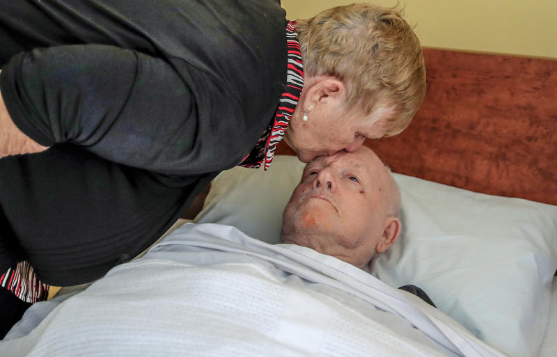 Lorraine Cook with her husband John at a Gold Coast nursing home after being transferred from the Earle Haven Nursing Home following its closure. Source: AAP / Tim Marsden