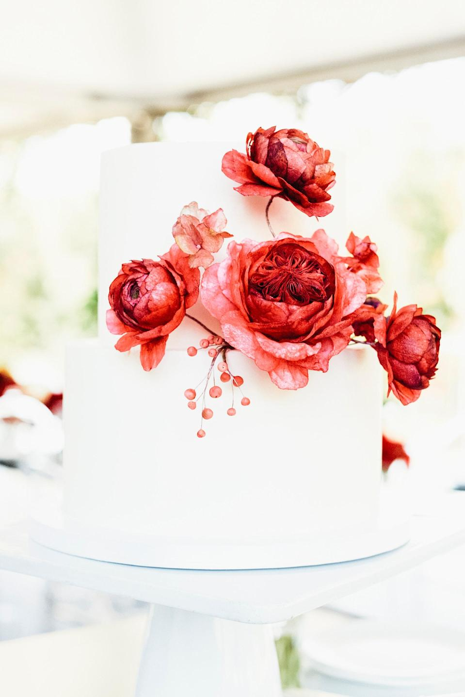 """<a href=""""https://www.millersandmakers.com/"""" rel=""""nofollow noopener"""" target=""""_blank"""" data-ylk=""""slk:Millers & Makers"""" class=""""link rapid-noclick-resp"""">Millers & Makers</a> made us a beautiful and delicious chocolate cake with vanilla icing. Each guest had their own mini version of this cake at their place-setting."""