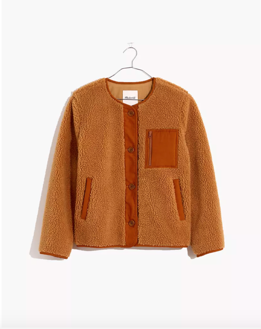 """<p><strong>Madewell</strong></p><p>madewell.com</p><p><a href=""""https://go.redirectingat.com?id=74968X1596630&url=https%3A%2F%2Fwww.madewell.com%2Fsherpa-chestnut-jacket-MA305.html&sref=https%3A%2F%2Fwww.cosmopolitan.com%2Fstyle-beauty%2Ffashion%2Fg34276815%2Fmadewell-jeans-sale-october-2020%2F"""" rel=""""nofollow noopener"""" target=""""_blank"""" data-ylk=""""slk:SHOP NOW"""" class=""""link rapid-noclick-resp"""">SHOP NOW</a></p><p><strong><del>$150</del> <del>$140</del> $98 (30% off)</strong></p><p>If you're all about that sherpa life these days, here's a cuddly chestnut option with <em>buttons</em>. Wear this jacket with jeans and a button down, or your favorite joggers around the house.</p>"""