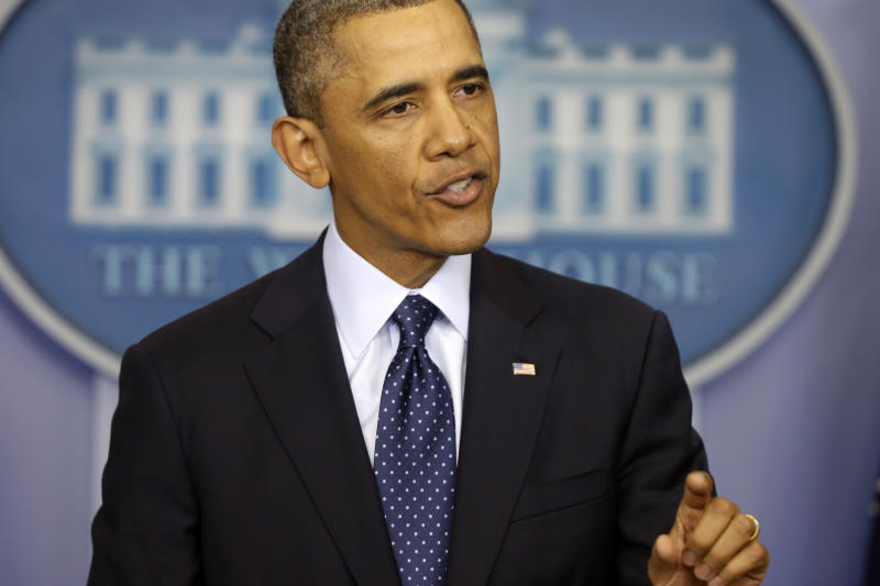 Obama calls spending cuts dumb, arbitrary