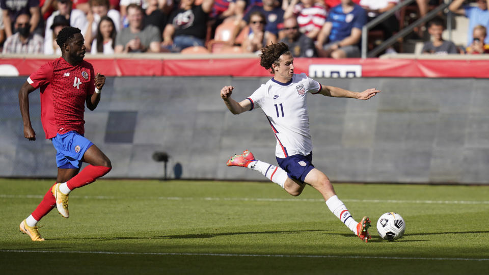 United States Brenden Aaronson kicks the ball as Costa Rica's Keysher Fuller (4) defends in the second half during an international friendly soccer match Wednesday, June 9, 2021, in Sandy, Utah. (AP Photo/Rick Bowmer)