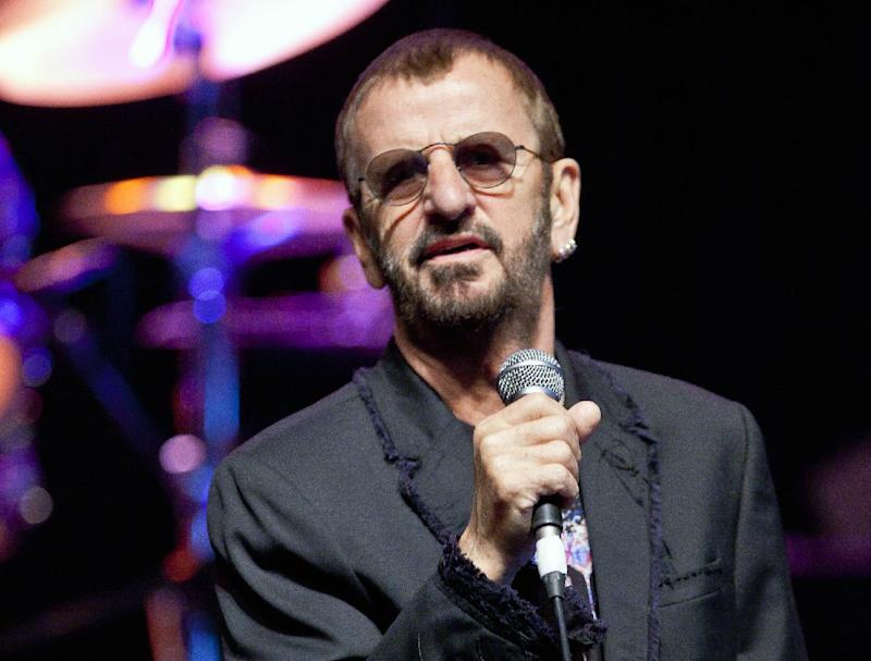 "FILE - This June 1, 2011 file photo shows British musician Ringo Starr  in Dunsfold, England. Starr will release ""Photograph,"" a collection of photos taken by Ringo and exclusive images from his personal archives. The material will first be published as an ebook, available exclusively on the iBookstore, on June 12, 2013, in conjunction with the Grammy Museum Exhibit, ""Ringo: Peace & Love"".  (AP Photo/Joel Ryan, file)"