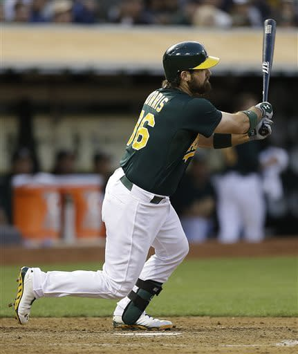 Oakland Athletics' Derek Norris follows through for a three-run home run off New York Yankees' CC Sabathia in the fourth inning of a baseball game Tuesday, June 11, 2013, in Oakland, Calif. (AP Photo/Ben Margot)