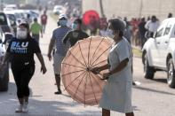 People are seen outside a polling station to cast their vote during the election for a new prime minister, in Benque Viejo del Carmen