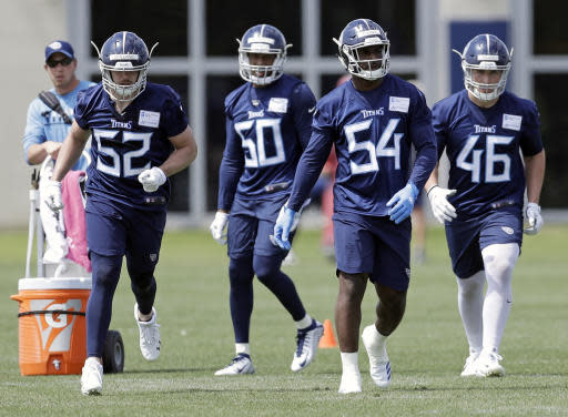 Tennessee Titans linebacker Rashaan Evans (54), the team's top draft pick, runs a drill with Robert Spillane (52), Chequan Burkett (50) and Nick DeLuca (46) during NFL football rookie minicamp Saturday, May 12, 2018, in Nashville, Tenn. (AP Photo/Mark Humphrey)