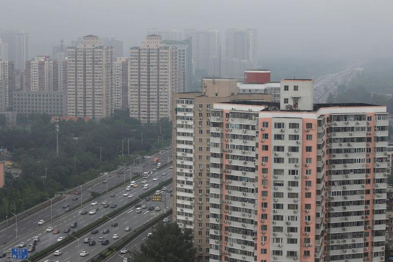 Residential buildings are seen along the Fourth Ring Road in Beijing