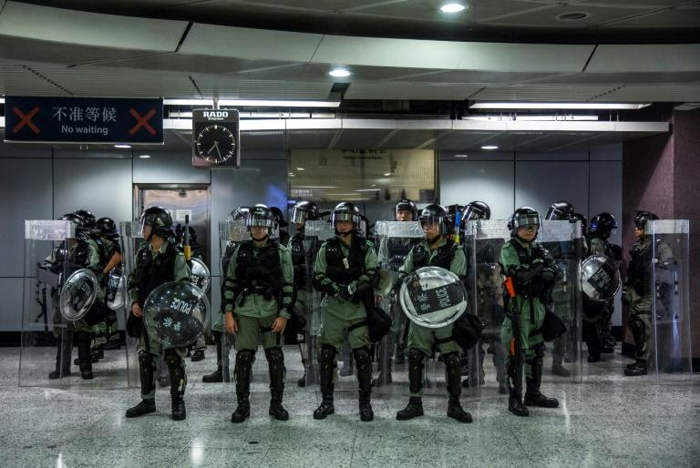 Hong Kong police have denied accusations of double standards in their treatment of pro-democracy protestors and their pro-China opponents (AFP Photo/ISAAC LAWRENCE)