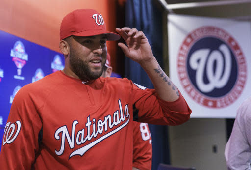 Newly acquired pitcher Kelvin Herrera walks from a new conference after speaking to the media before a game against the Baltimore Orioles, Tuesday, June 19, 2018, in Washington. (AP Photo/Carolyn Kaster)