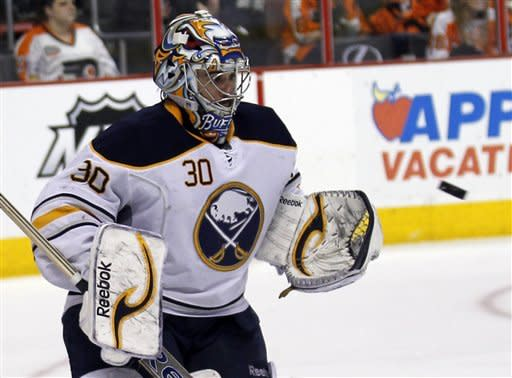 Buffalo Sabres goalie Ryan Miller (30) makes a save in the second period of an NHL hockey game with the Philadelphia Flyers, Thursday, April 5, 2012, in Philadelphia. (AP Photo/Alex Brandon)