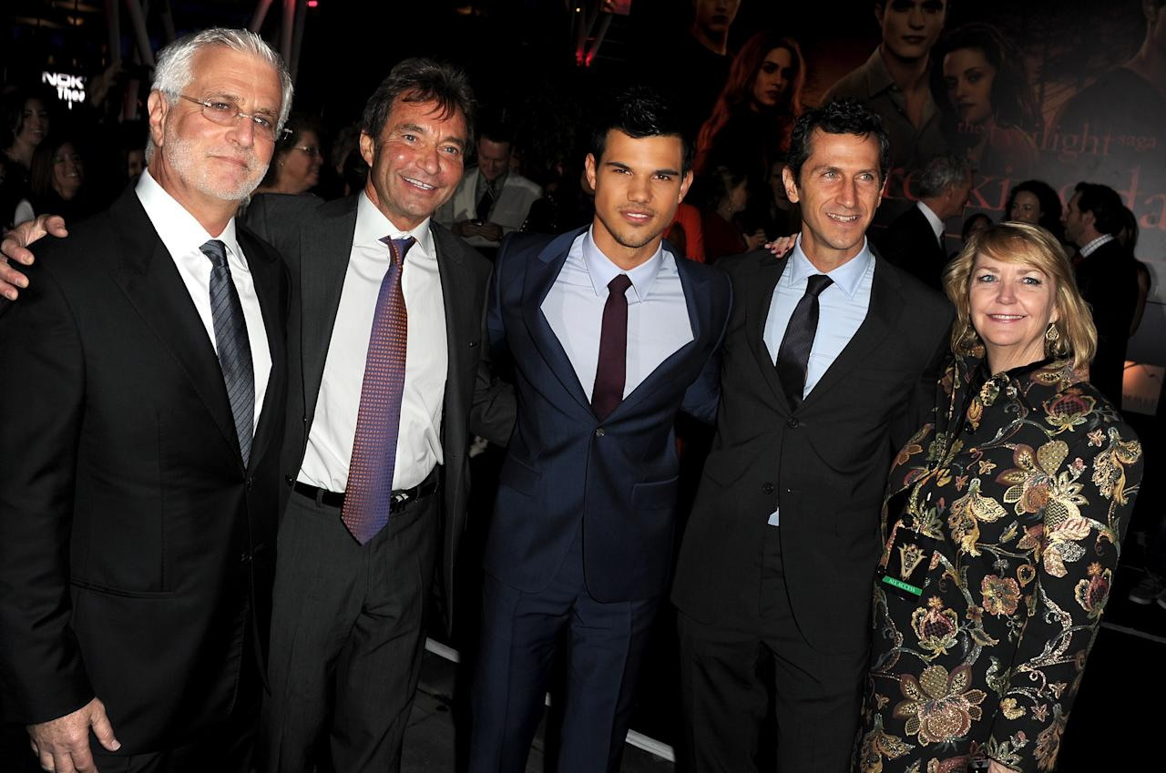 "LOS ANGELES, CA - NOVEMBER 14:  Summit Entertainment Co-Chairman Rob Friedman, Summit Entertainment President & CEO Patrick Wachsberger, actor Taylor Lautner, Summit Entertainment President of Worldwide Production and Acquisitions Erik Feig, and president of worldwide marketing for Summit Entertainment Nancy Kirkpatrick arrive at the premiere of Summit Entertainment's ""The Twilight Saga: Breaking Dawn - Part 1"" at Nokia Theatre L.A. Live on November 14, 2011 in Los Angeles, California.  (Photo by Kevin Winter/Getty Images)"