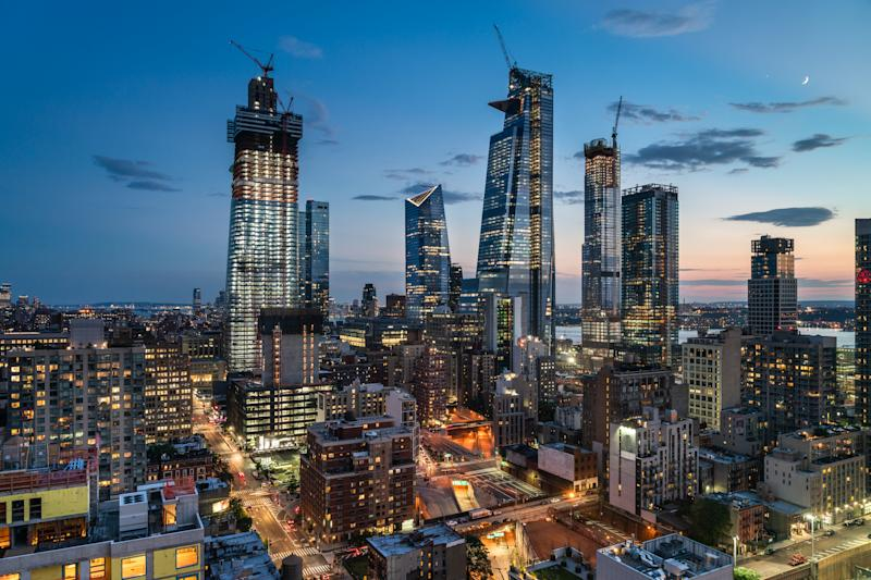 Large scale development projects are underway on the far west side of Manhattan near 34th Street and the Hudson River. This high angle view above Ninth Avenue looks south toward Manhattan West and Hudson Yards, two of the large development projects. Seen in the background are the Hudson River and Jersey City. Also seen in the foreground are access roads to the Lincoln Tunnel.