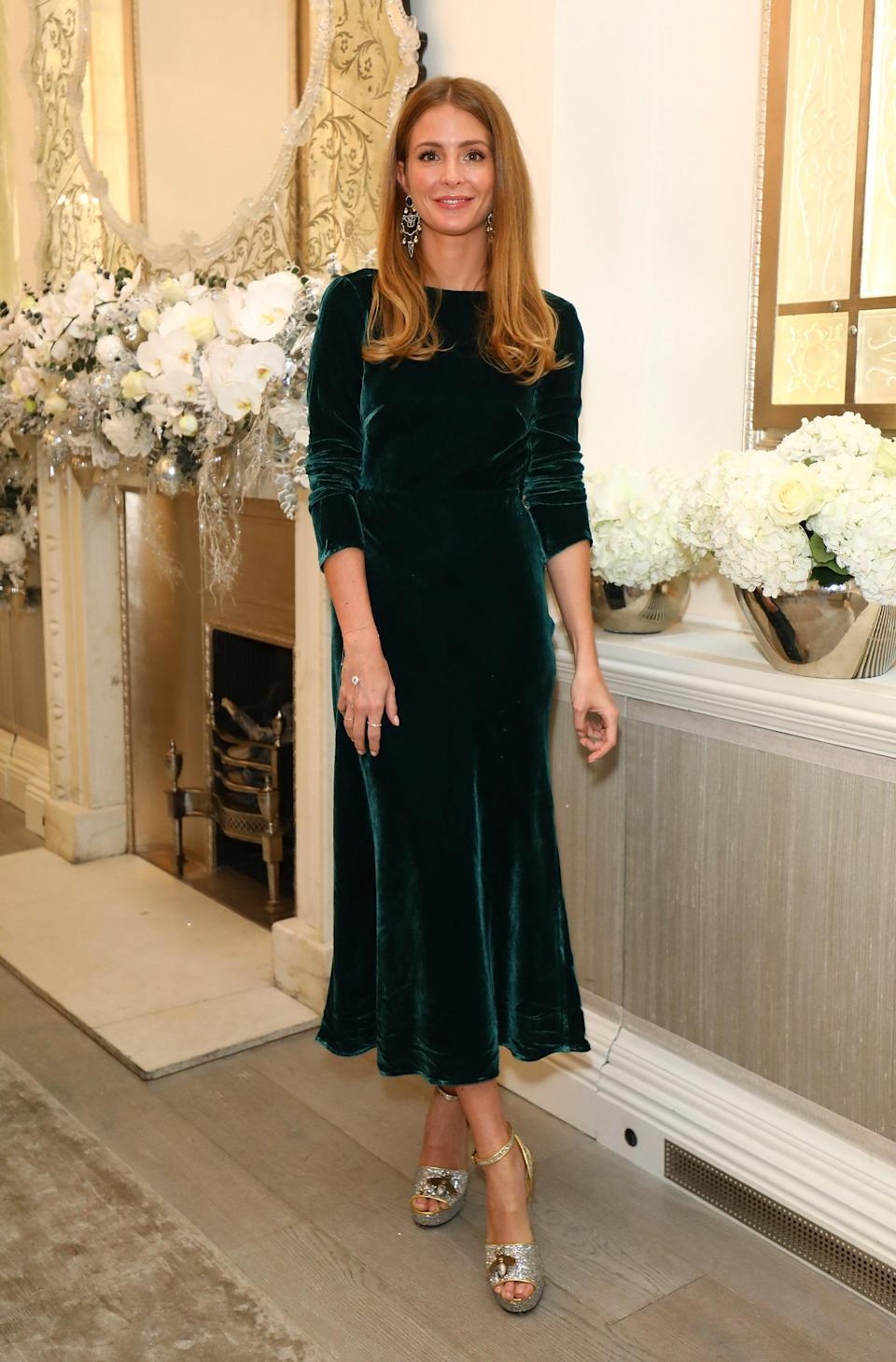 <p>The former reality star wore an emerald green velvet dress by Saloni for the event at Annabel's in Mayfair. <em>[Photo: Getty]</em> </p>
