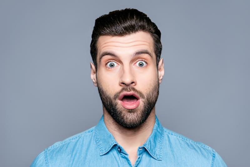 Man with raised eyebrows and surprised expression.