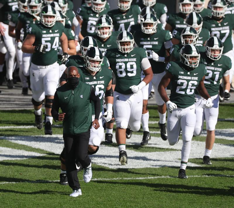 Michigan State coach Mel Tucker leads his team onto the field before action the game against Rutgers on Saturday, Oct. 24, 2020, at Spartan Stadium.