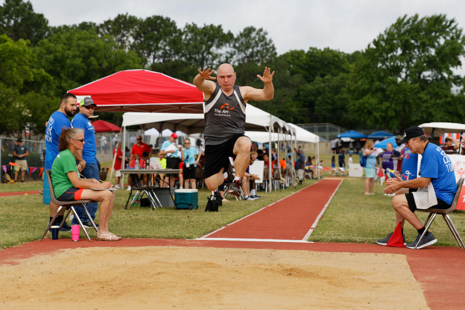 "In this photo provided by Gary Schottle, Derek ""Tank"" Schottle competes in the long jump as part of the Pentathlon competition at the Texas Special Olympics track meet in Arlington, Texas, on May 27, 2017. The Special Olympics, founded by Eunice Kennedy Shriver, have melded competition and inclusion for people with intellectual disabilities since the first games were held in 1968. Special Olympics has since branched out to 174 countries, empowering more than five million athletes who had often been cast aside.(Gary Schottle via AP)"