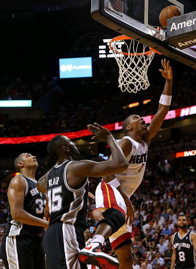 MIAMI, FL - NOVEMBER 29: Chris Bosh #1 of the Miami Heat drives to the basket during a game against the San Antonio Spurs at American Airlines Arena on November 29, 2012 in Miami, Florida. (Photo by Mike Ehrmann/Getty Images)