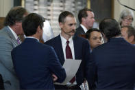 Texas State Rep. Andrew Murr, R-Kerrville, center, talks with fellow law makers as the House debates election bill SB1 in the House Chamber at the Texas Capitol, Thursday, Aug. 26, 2021, in Austin, Texas. (AP Photo/Eric Gay)