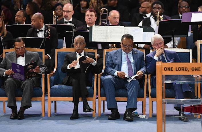 Former US president Bill Clinton (right) was criticized for sharing the front row with Farrakhan at Aretha Franklin's funeral in 2018 (AFP Photo/Angela Weiss)
